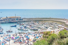 Lyme Regis 6th July 2019 A view down over Lyme Regis harbour from Langmoor and Lister gardens